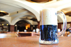 Pint of black beer on the table in the pub Royalty Free Stock Photography