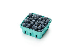 Pint container of blueberries on white Royalty Free Stock Photography