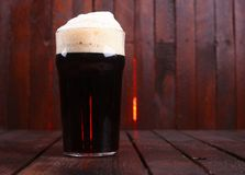 Pint of dark beer Stock Images