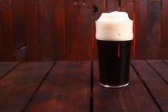 Pint of dark beer Stock Photography