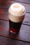 Pint of dark beer Stock Photos