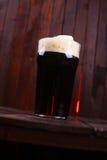 Pint of dark beer Stock Image