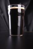 Pint of dark beer Royalty Free Stock Photo