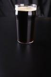 Pint of dark beer Royalty Free Stock Images