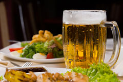 Pint of delicious cold beer in a mug Stock Photography