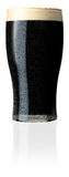 Pint of Draft Irish Stout. Isolated pic of a Pint of Draft Irish Stout Stock Images
