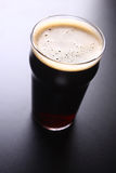 Pint glass of beer Stock Photos
