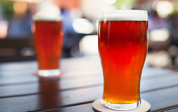 Pint glass of craft beer on table Stock Photography