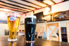 Pint of Guinness and Kronenbourg 1664 Stock Photos