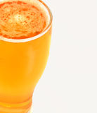 Pint of lager beer. A pint of thirst quenching lager beer against a white background royalty free stock photo