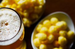 Pint of lager beer in a glass, set of various snacks, a standard. Set of drinking and eating in a pub, beer and snacks Stock Photos