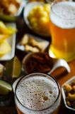 Pint of lager beer in a glass, set of various snacks, a standard. Set of drinking and eating in a pub, beer and snacks royalty free stock image