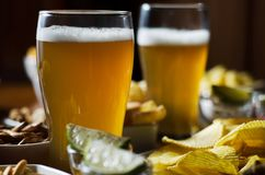 Pint of lager beer in a glass, set of various snacks, a standard. Set of drinking and eating in a pub, beer and snacks royalty free stock photos