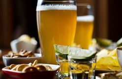 Pint of lager beer in a glass, set of various snacks, a standard. Set of drinking and eating in a pub, beer and snacks royalty free stock photography