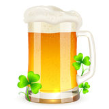 Pint of light beer with clovers Stock Photo