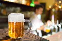 Pint In Pub. A glass of beer in the pub royalty free stock photo