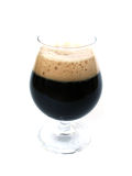 Pint of stout beer. Pint of stout on white background high key, brown foam,beer isolated royalty free stock photo