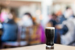 Pint of stout in a cafe bar Royalty Free Stock Photography