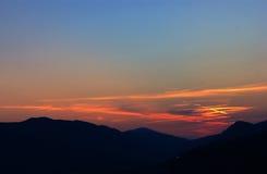 Pinta o céu do por do sol Imagens de Stock