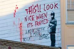 Pintada de Banksy Imágenes de archivo libres de regalías