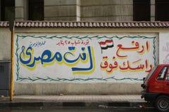 Pintada de la revolución - lleve a cabo su cabeza encima del alto Imagen de archivo