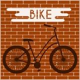 Pintada de la silueta de la bicicleta en la pared de ladrillo ilustración del vector