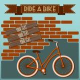 Pintada de la silueta de la bicicleta en la pared de ladrillo stock de ilustración