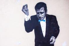 Pintada de un hombre con el vestido negro imágenes de archivo libres de regalías