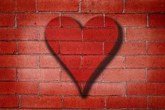 Pintada del corazón de la pared de ladrillo Imagen de archivo