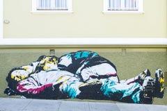 Pintada el dormir del hombre y del niño Imagenes de archivo