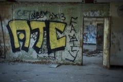 Pintada en el edificio abandonado Foto de archivo