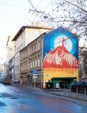 Pintada en fachada del edificio Fotos de archivo