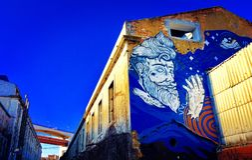 Pintada en L fábrica de X - Lisboa imagenes de archivo