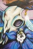 Pintada en la pared de ladrillo con el cráneo de la vaca Fotografía de archivo libre de regalías