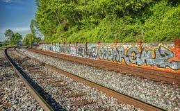 Pintada en las pistas de ferrocarril Imagen de archivo libre de regalías