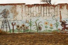 Pintada en una pared de ladrillo Foto de archivo libre de regalías