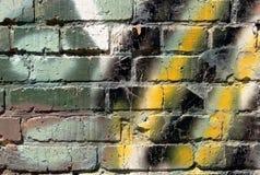 Pintada en una pared de ladrillo Fotos de archivo libres de regalías