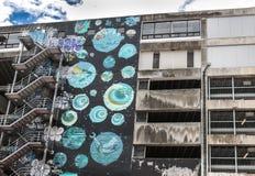 Pintada pintada en la pared de un edificio Imagen de archivo