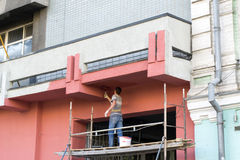Pintando a fachada Imagens de Stock