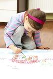 Pintando mi casa ideal - pintura de la muchacha Foto de archivo libre de regalías