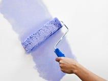 Pintando a parede Foto de Stock Royalty Free