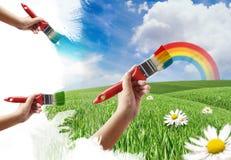 Pintando um prado e um arco-íris Fotografia de Stock Royalty Free