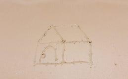 Pintando uma casa na areia Foto de Stock