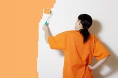 Pintando uma parede Imagem de Stock