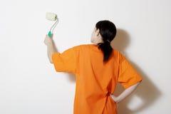 Pintando uma parede Fotos de Stock Royalty Free