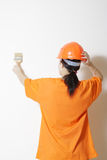 Pintando uma parede Fotos de Stock