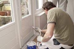 Pintando uma porta branca Imagem de Stock Royalty Free