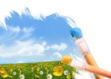 Pintando un campo lleno de flores salvajes Imágenes de archivo libres de regalías