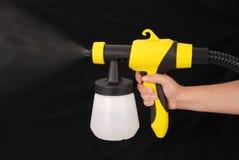 Pinte el arma de espray Imagenes de archivo