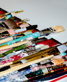 Pinte escovas chapinhadas da arte Imagens de Stock